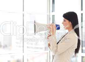 Businesswoman shouting in a megaphone