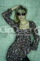 young blonde with sunglasses is posing