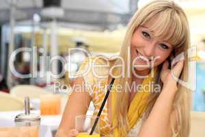 beautiful young blond woman with a glass of juice