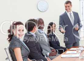 Business people in a meeting listening to a colleague