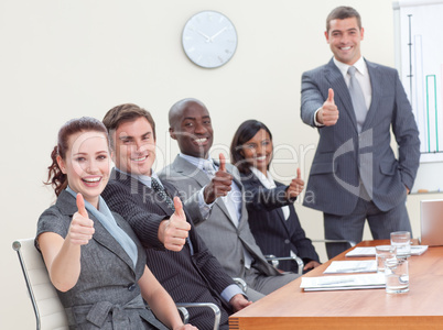 Businessteam with thumbs up after a presentation
