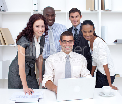 International businessteam using a laptop together