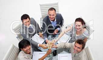 High angle of business team drinking champagne in the office