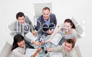 High angle of smiling business team holding molecules