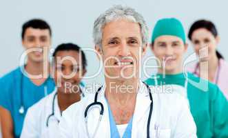 Senior doctor standing in front of his team