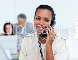 Charming businesswoman talking on phone