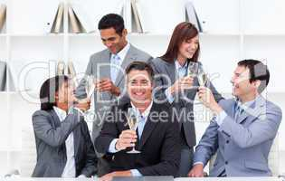 Cheerful business people toasting with Champagne