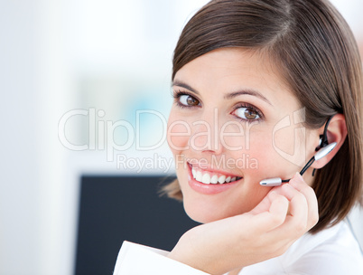 Cute businesswoman talking with clients in front of her computer