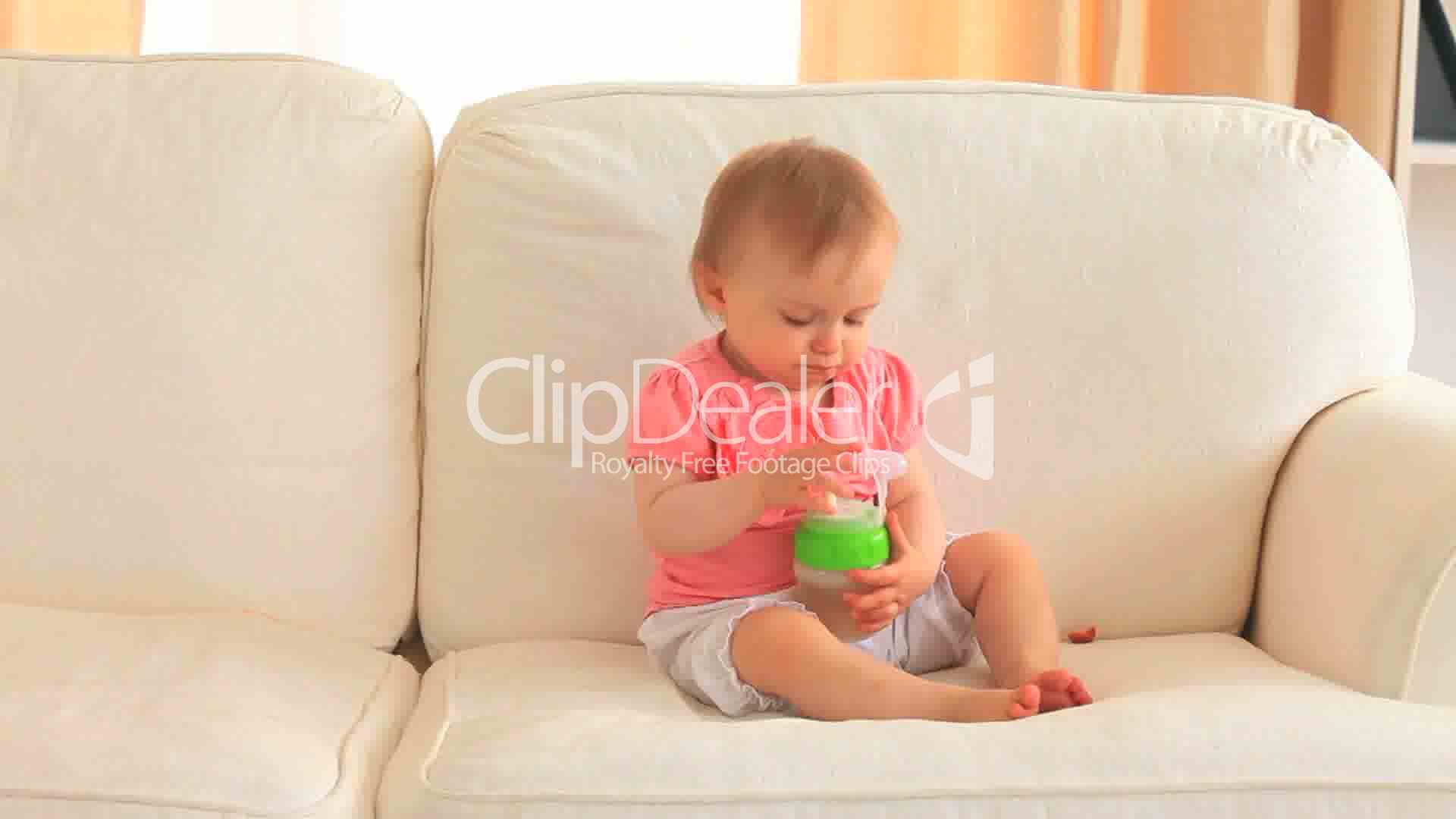 baby auf der couch royalty free video and stock footage. Black Bedroom Furniture Sets. Home Design Ideas