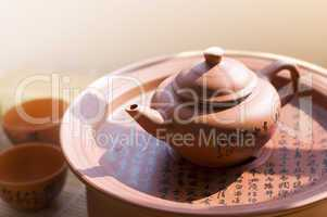 Chinese ceramic teapot and cups.