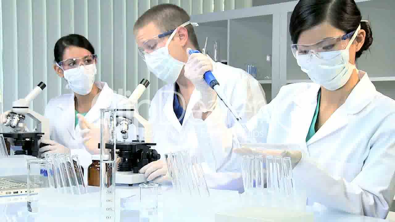 Three Assistants in Medical Research Laboratory: Royalty ...