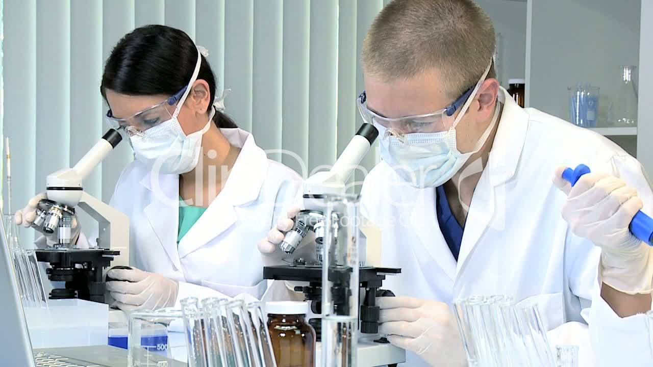 Three Research Students Working in Medical Laboratory ...