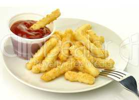 fried potatoes in a white plate