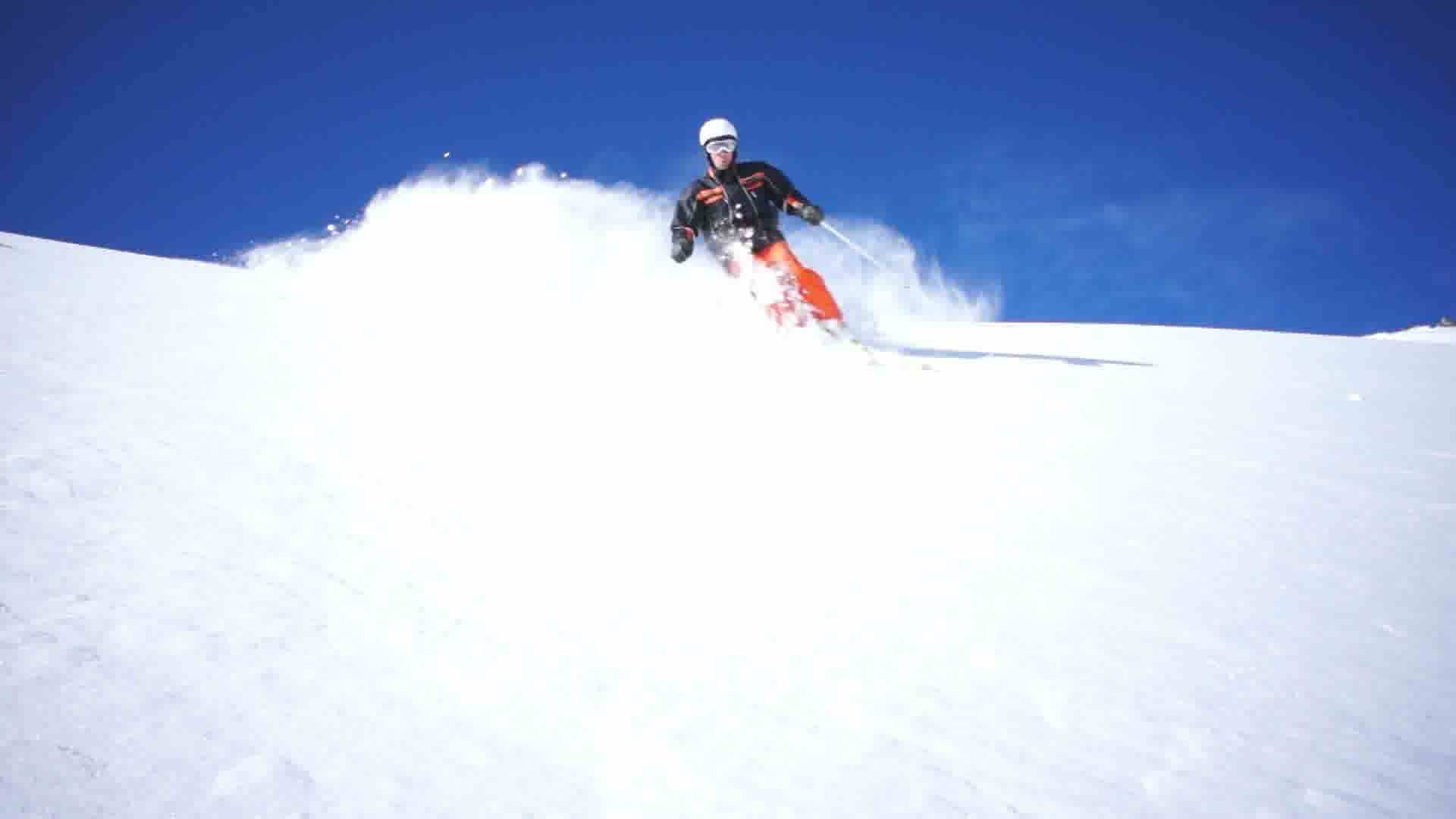 Man skiing in powder snow royalty free video and stock