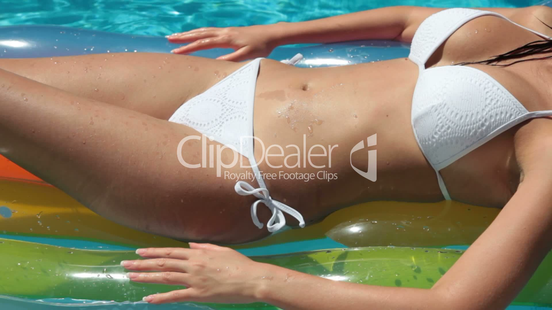 Bikini female on air bed in swimming pool royalty free for Swimming pool bed