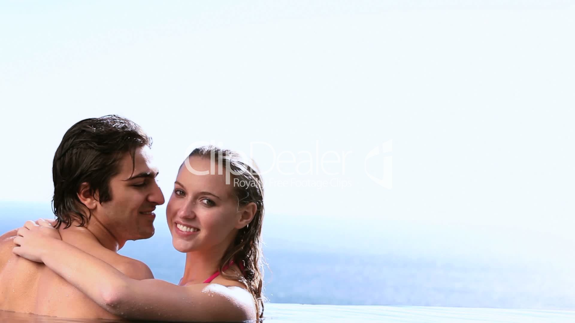 Couple Kissing Next To A Swimming Pool Royalty Free Video And Stock Footage