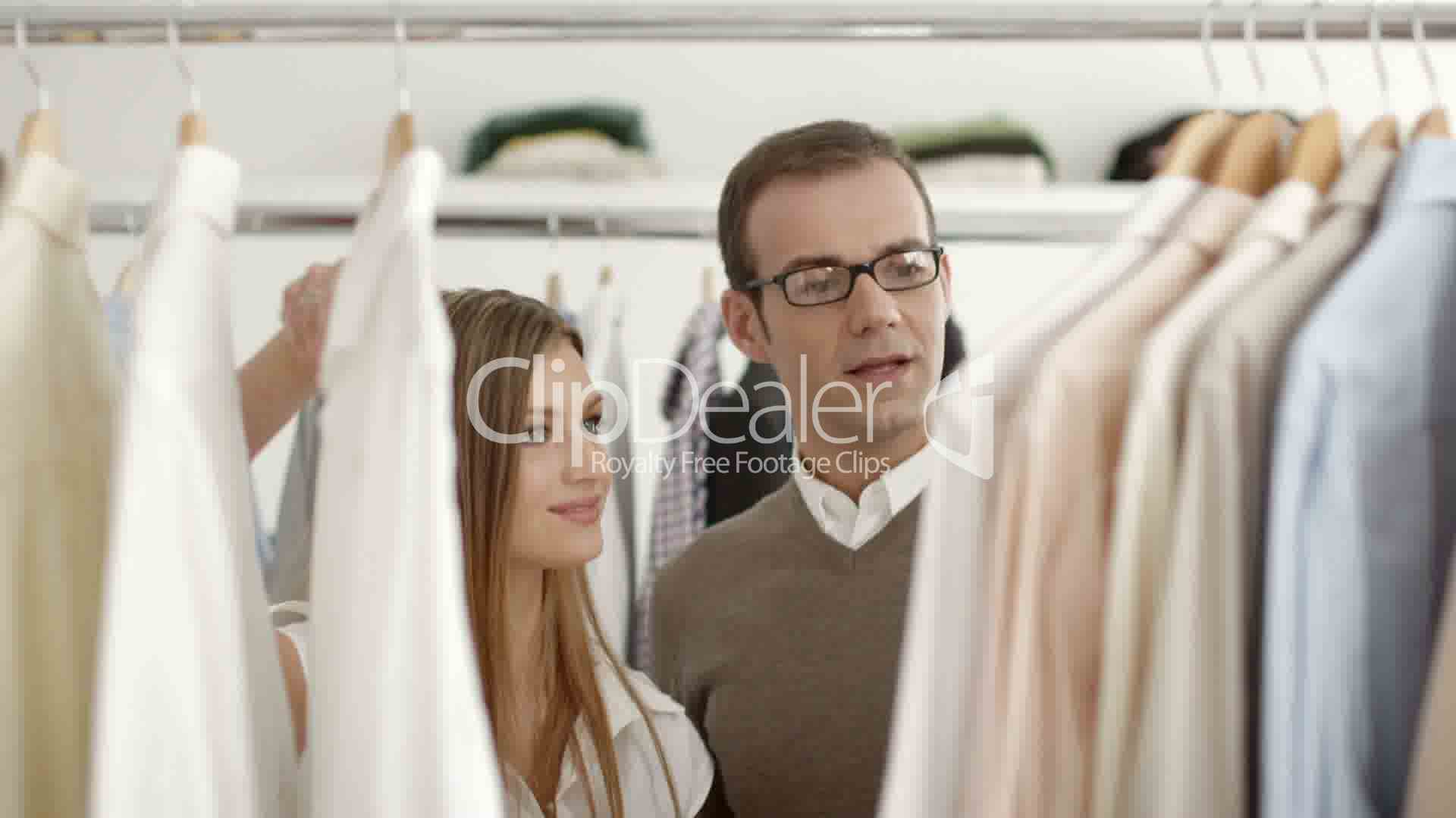 man talking    s assistant in clothes shop  royalty      clips  man talking    s assistant in clothes shop