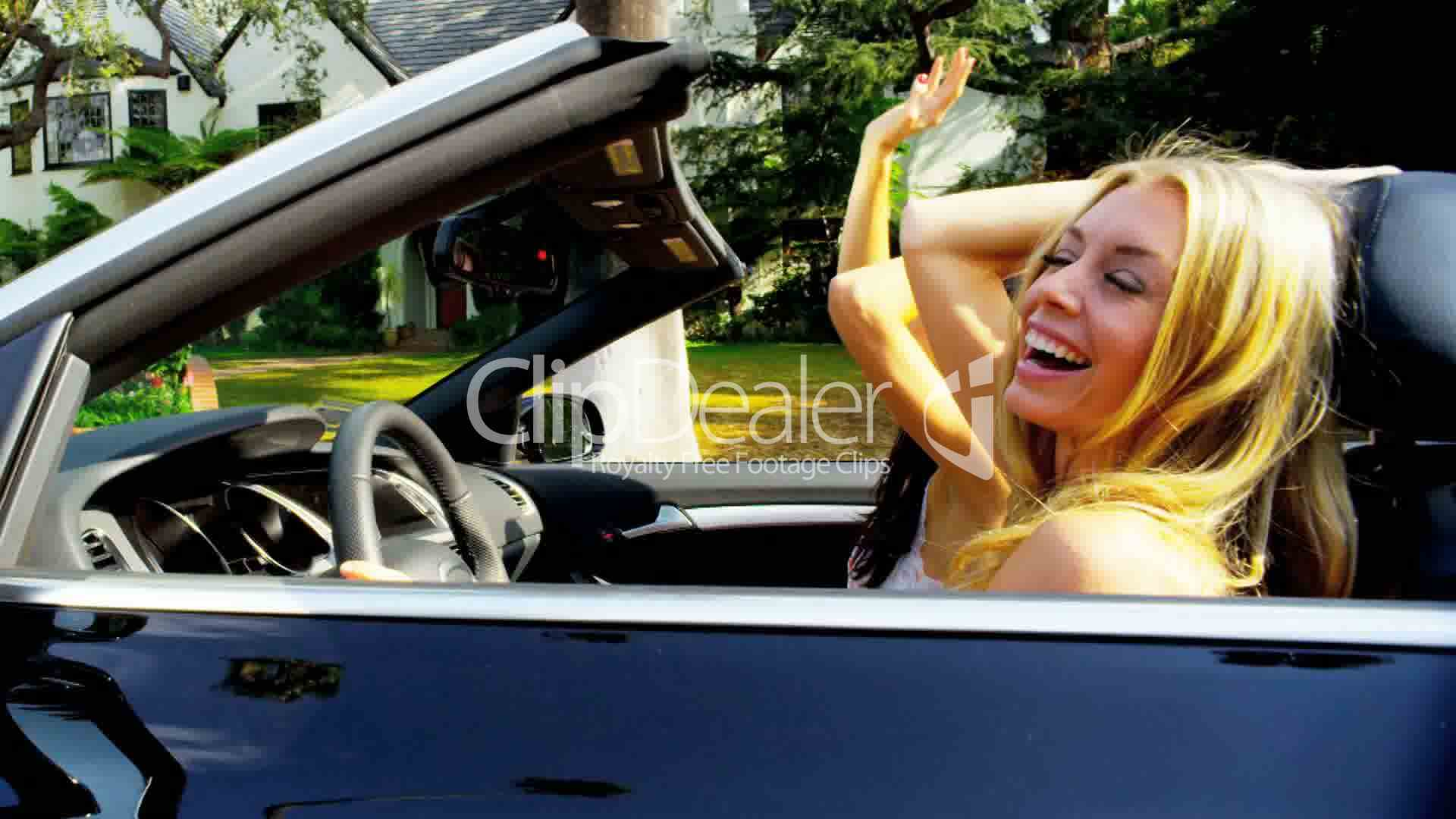 Girls singing laughing in luxury convertible royalty free video and