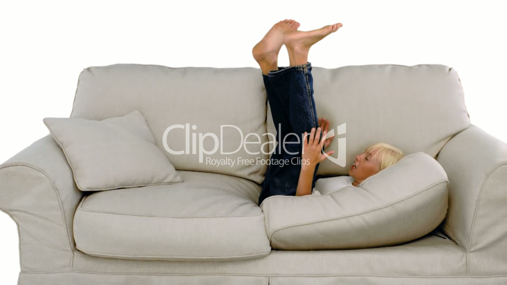 Young Boy Jumping On The Sofa On White Background Royalty