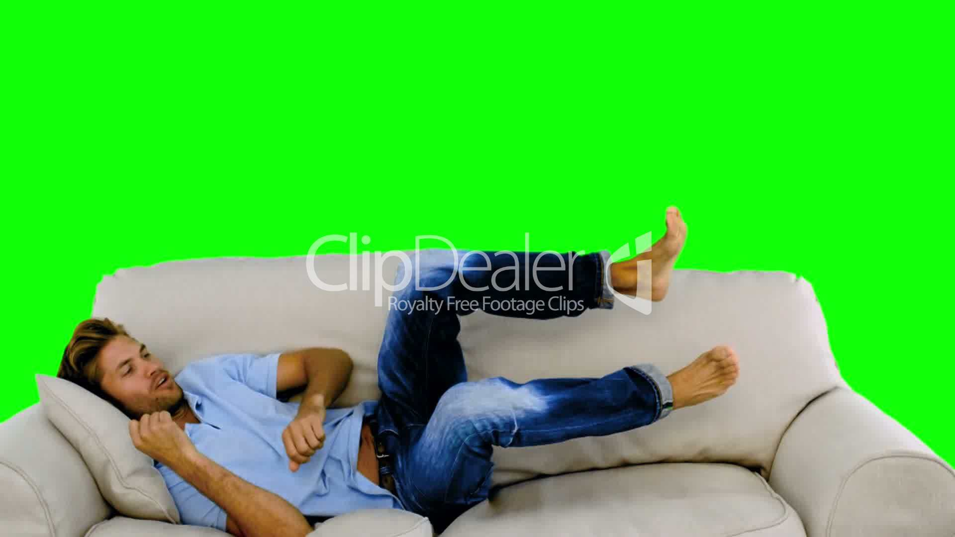 Man Jumping On The Sofa On Green Screen Royalty Free