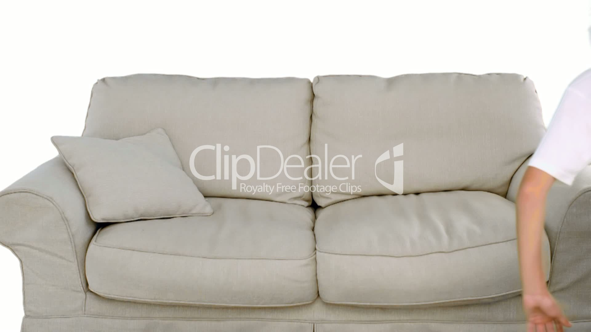 Boy Jumping On The Sofa On White Background Royalty Free