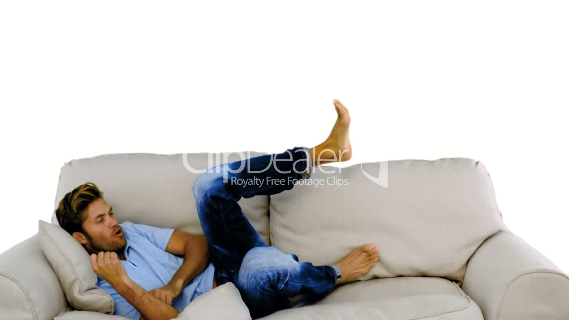 Man Jumping On The Sofa On White Background Royalty Free
