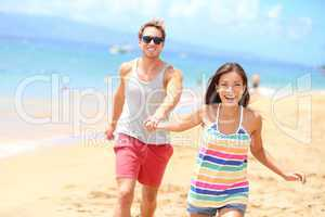 Beach couple having fun romantic vacation holiday