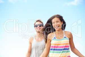 Young couple enjoying beach fun laughing running