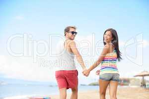 Beach vacation fun with cool trendy hipster couple