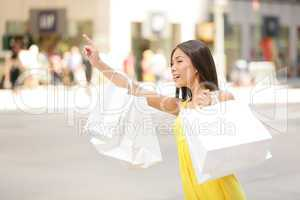 Shopping woman in New York City looking for taxi