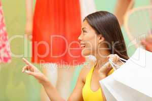 Shopping woman looking at clothing window display