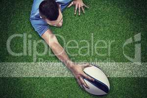 Composite image of rear view of rugby player lying in front with