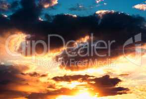 Dramatic sunset cloudscape with sun rays background