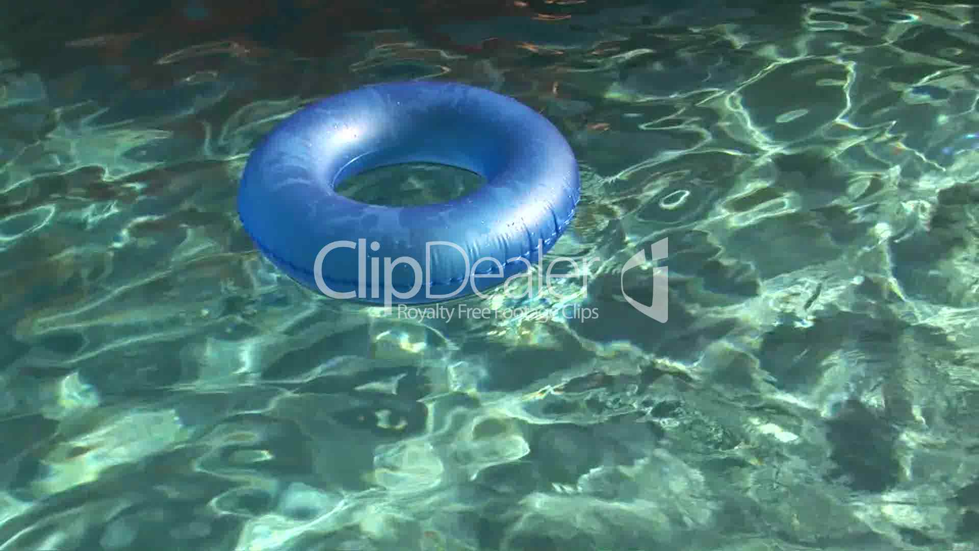 Inner Tube Floating In A Swimming Pool Royalty Free Video