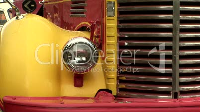 Closeup of headlight and grill of old truck