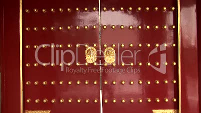Red Chinese Doors with Gold Lion Handles