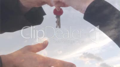 Stock Footage of a Businessman Handing over Keys