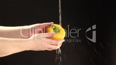 Stock Footage of washing a Pepper