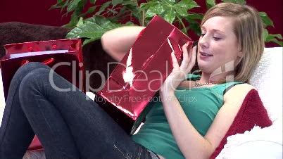 Woman on Sofa with Christmas Presents