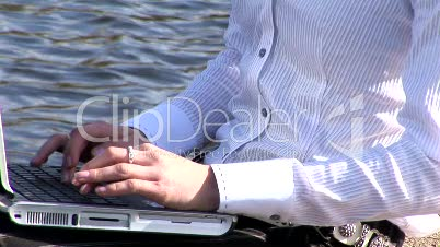 Woman on laptop outdoors 4