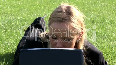Woman on laptop outdoors 5