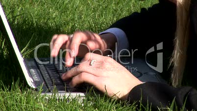 Woman on laptop outdoors 10