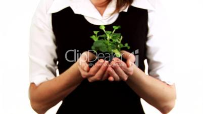 Woman Holding a plant in her hands