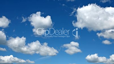 Motion background - white clouds flying on blue sky