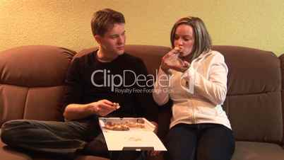 HD1080i Young couple eating pizza