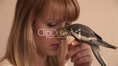 HD1080i Young woman and cockatiel