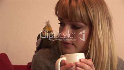 HD1080i Young woman watching tv and drinking a cup of coffee