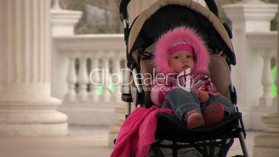 Smiling girl in stroller