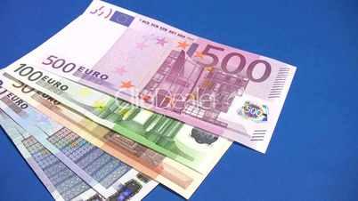 Euro cash money on blue background