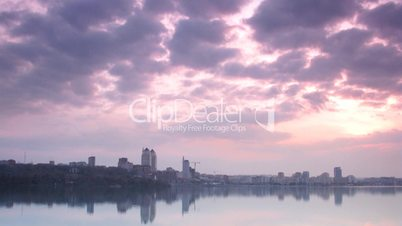 time lapse. city landscape on sunset.